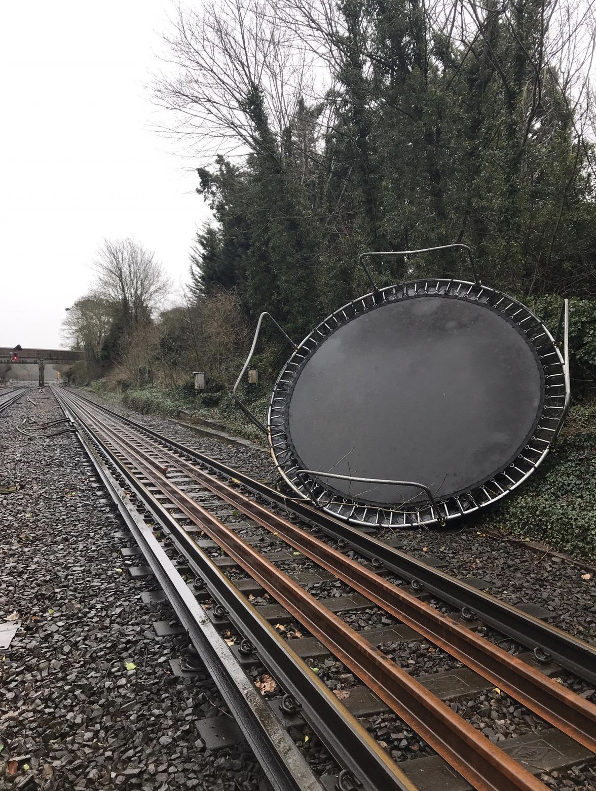 of this work, hereby publish it under the following license: English A trampoline blocks the railway line in south east England during a storm with strong
