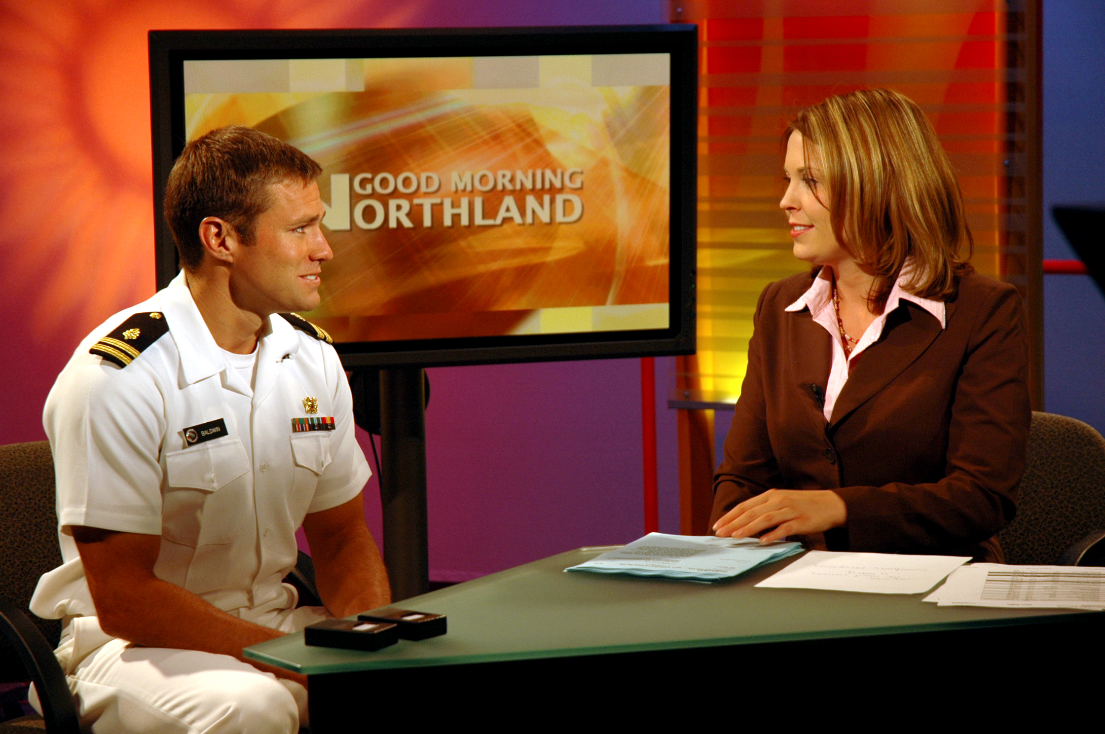 us navy 080714-n-7006n-002 lt. andrew baldwin, m.d., assigned to the navy bureau of medicine and surgery, speaks with cassie limpert about navy medicine and the medical opportunities the navy has to offer during an airing of th.jpg