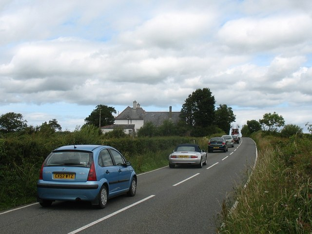 File:A traffic tail back behind a tractor by the former Coedana Rectory - geograph.org.uk - 1399270.jpg