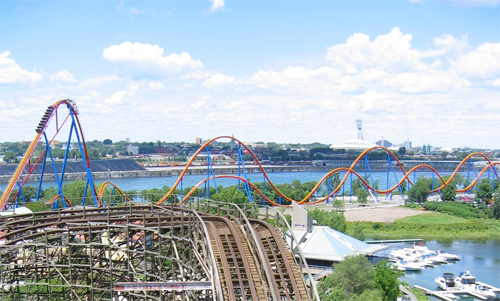 View from the top of The Monster rollercoaster at La Ronde amusement park. The Goliath is the red, yellow and blue ride to the north. Photo by Pragash Thandayutham.