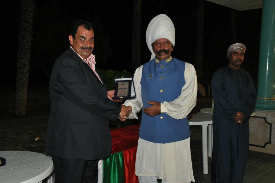 Malik Ata receiving medal from General Atif of Oman at Asian Beach Games 2010, Oman