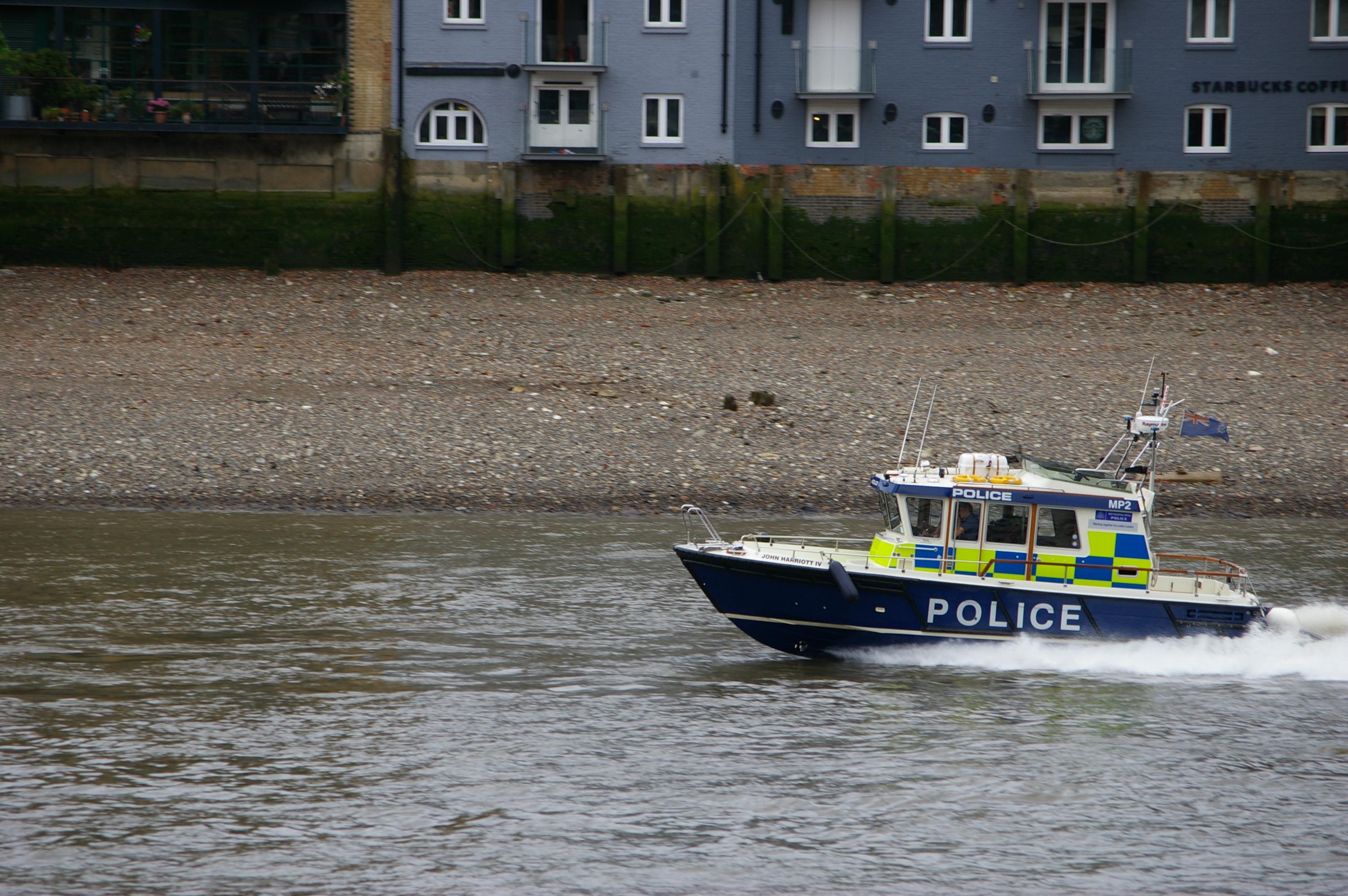 Description police boat on river thames