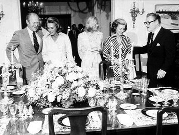 Vice President Rockefeller (right) and his wife Happy (second on left) entertain President Gerald R. Ford (left) his wife Betty (second on right) and their daughter Susan (center) at Number One Observatory Circle on September 7, 1975. 1OCDining.jpg