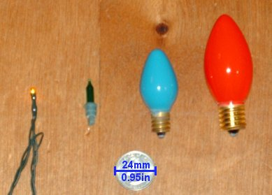 The four most common bulb sizes used in the United States. From left to right: &quotrice&quot style LED (0.057w), T1¾ &quotmidget&quot (0.5w), C7½ (5w) and C9¼ (7.5w). Quarter shown for size comparison. - Holiday lighting technology