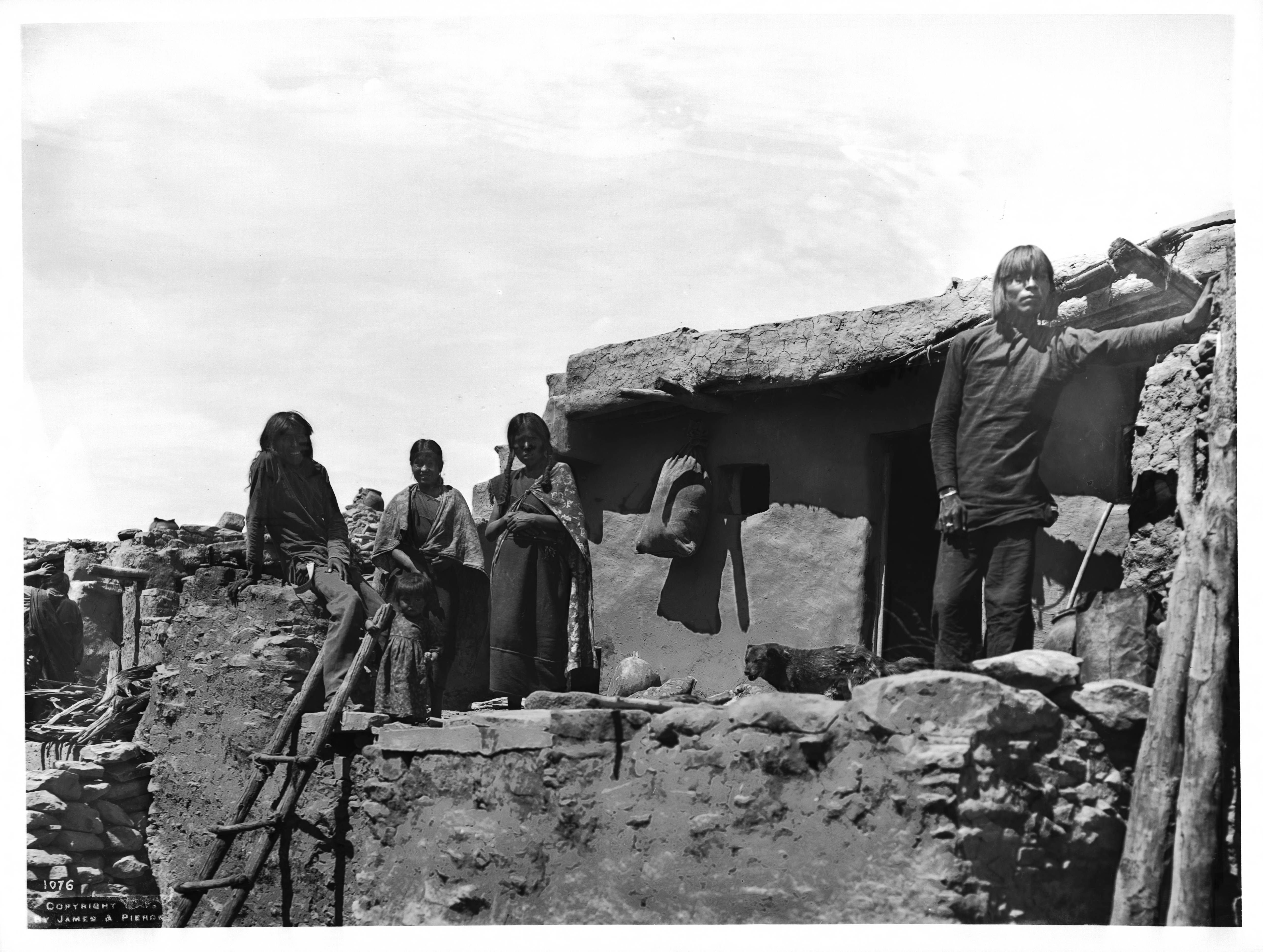 File Four Members Of A Hopi Indian Family On Top Of An Adobe House In The Village Of Oraibi  Ca