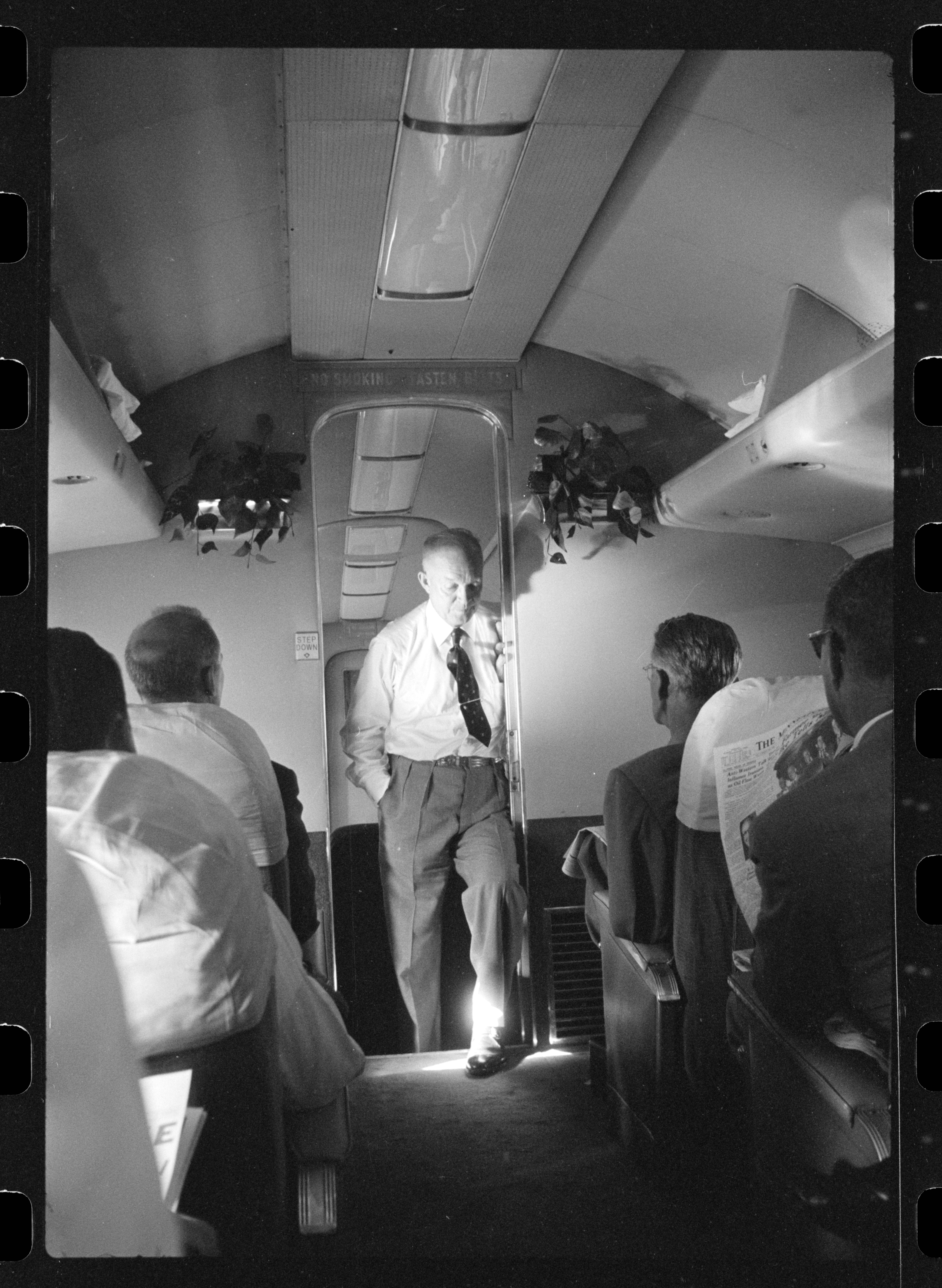 Republican presidential candidate Dwight D. Eisenhower talking with reporters(?) on his campaign airplane.jpg