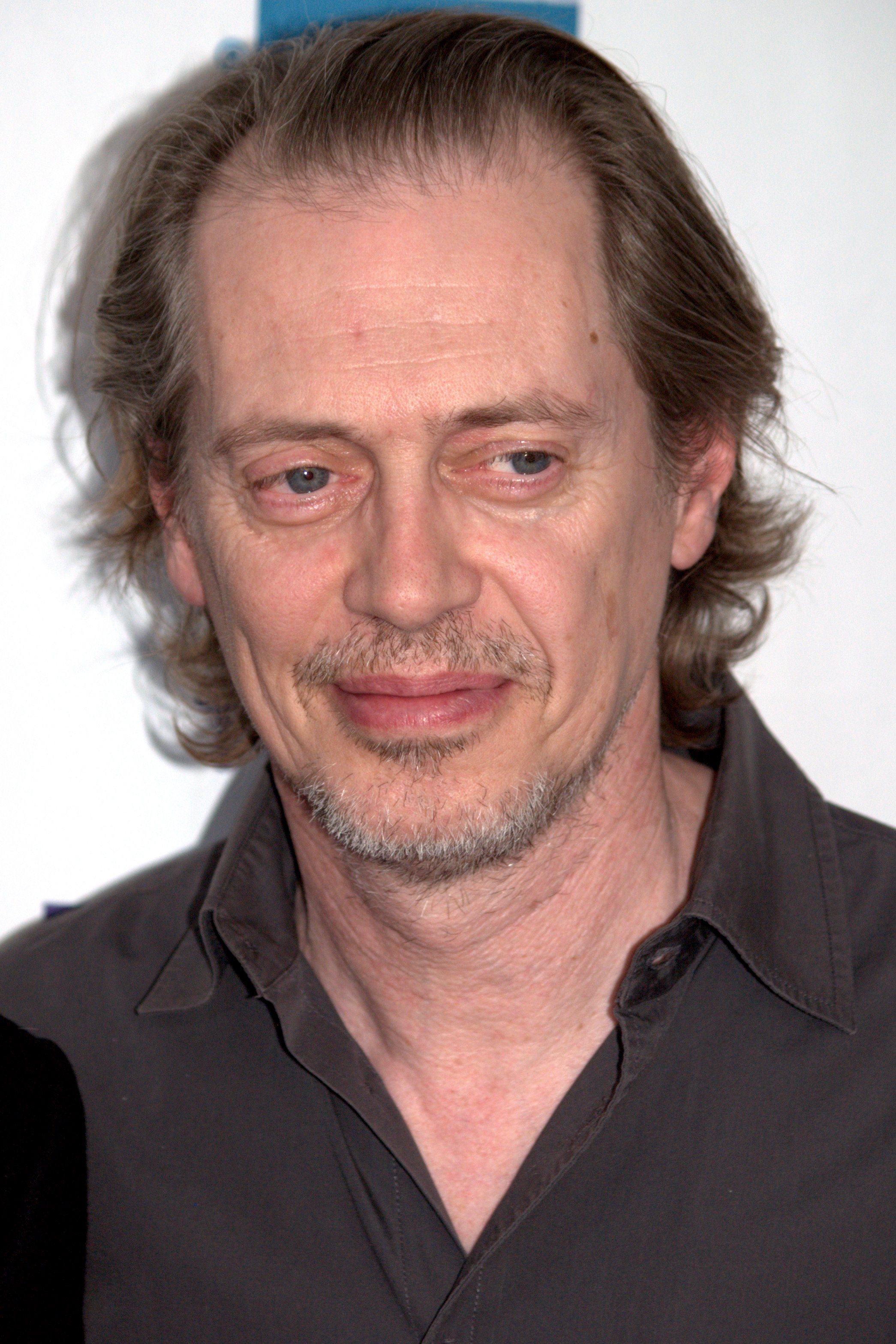 The 60-year old son of father John Buscemi and mother Dorothy Buscemi, 175 cm tall Steve Buscemi in 2018 photo