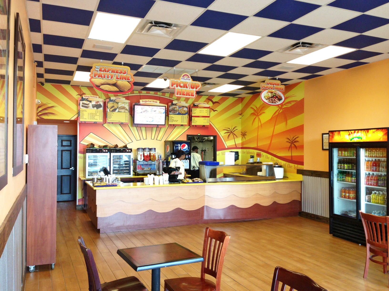 An Interior Of A Golden Krust Restaurant