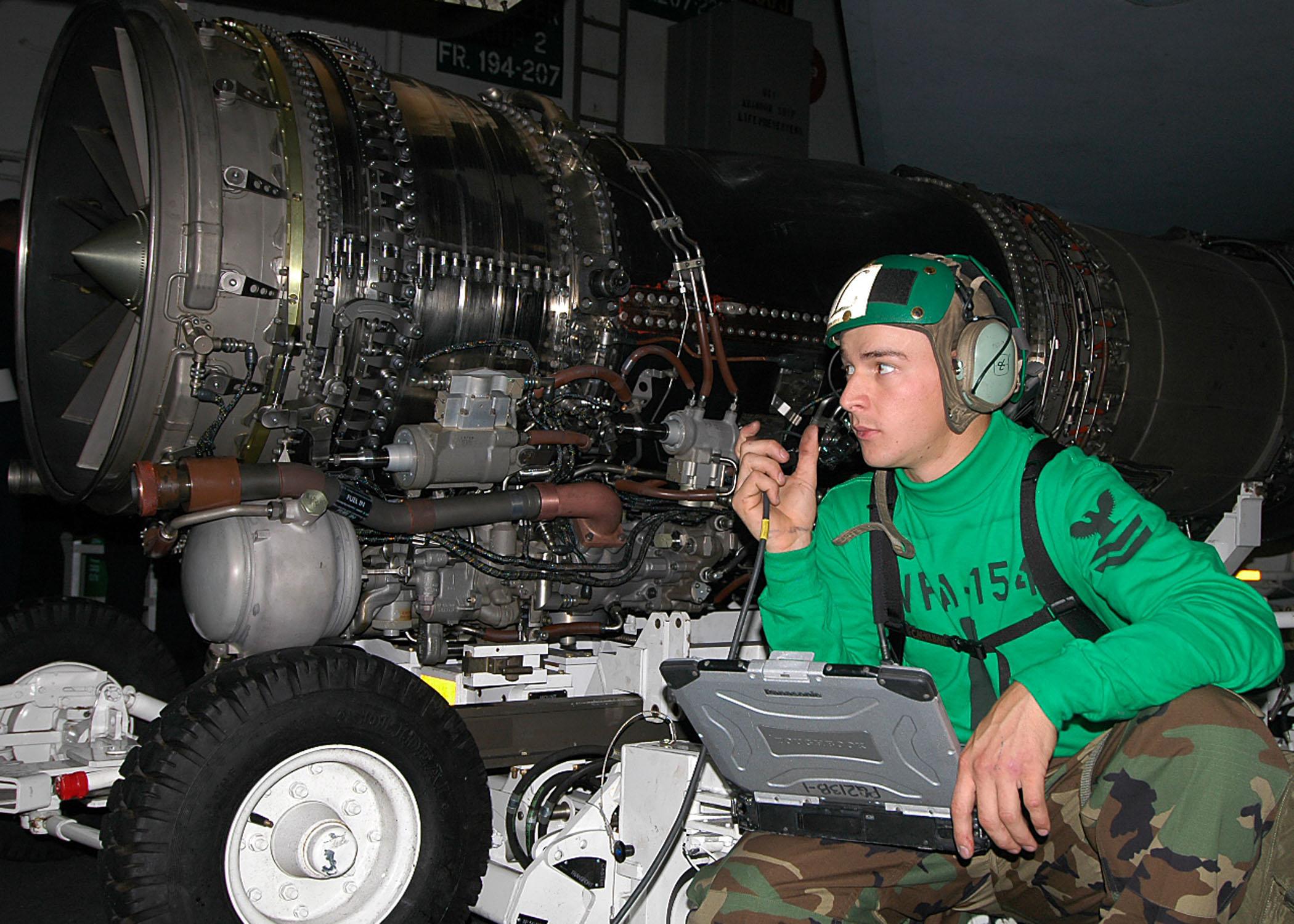fileus navy 060627 n 5024r 001 aviation structural mechanic equipment 2nd class greg harman conducts a 600 hour periodic maintenance check on a jet engine turbine engine mechanic