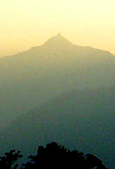 The mountain has a natural linga on its peak.