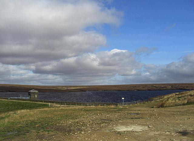 reservoir under cloudy sky