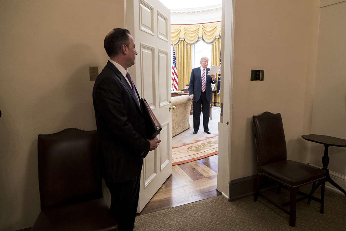 File Chief Of Staff Reince Priebus Looks Into The Oval