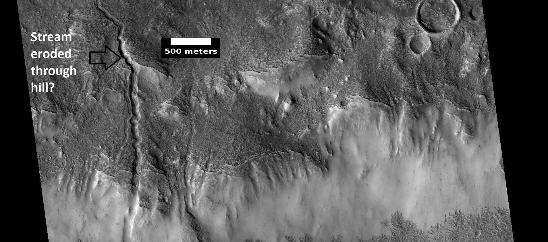 Channels, as seen by HiRISE under HiWish program. Stream appears to have eroded through a hill.