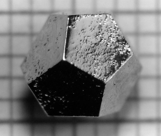 The material Holmium–Magnesium–Zinc (Ho–Mg–Zn) forms quasicrystals, which can take on the macroscopic shape of a dodecahedron. (Only a quasicrystal, not a normal crystal, can take this shape.) The edges are 2mm long.