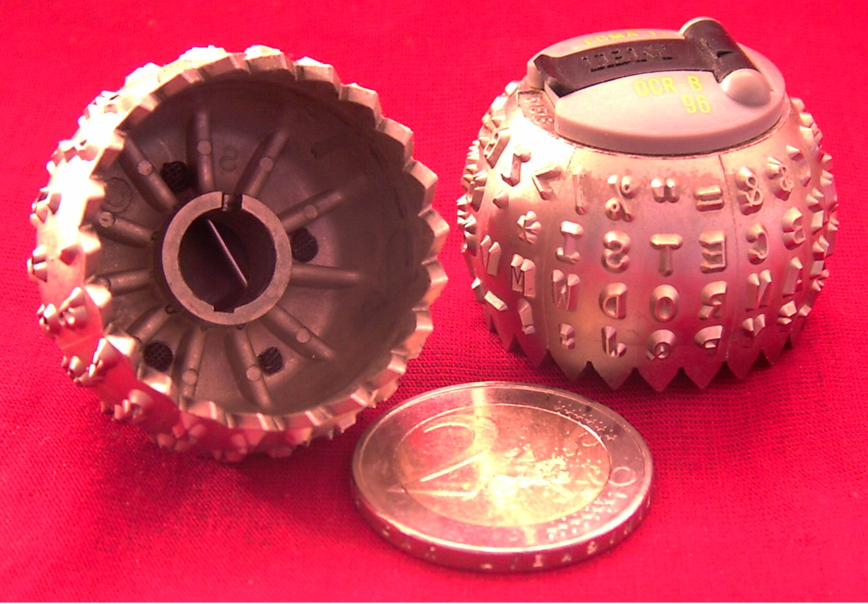 IBM typeballs (one OCR) with clip, 2 coin for scale