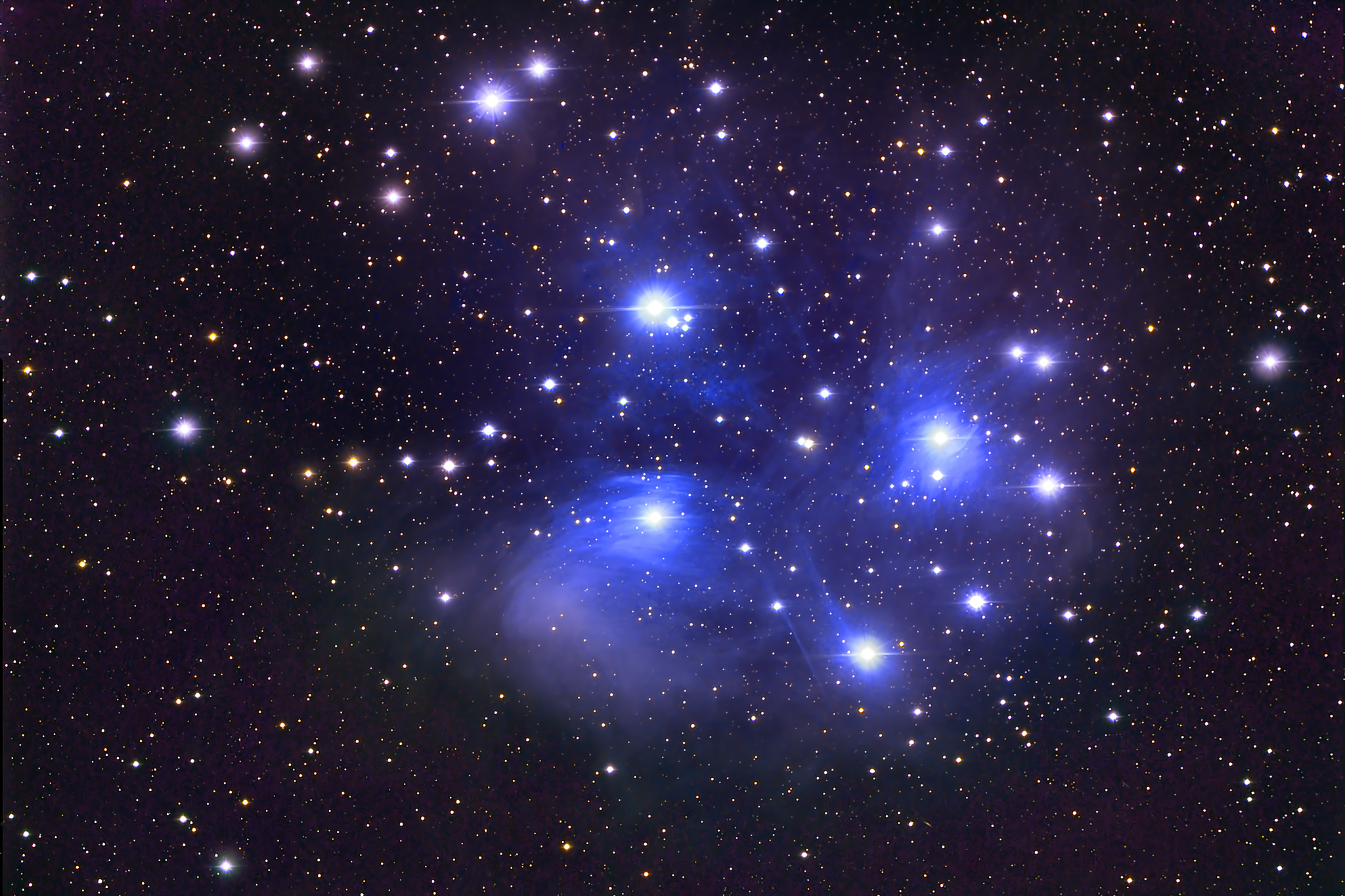The Pleiades - several blue stars against a black backdrop