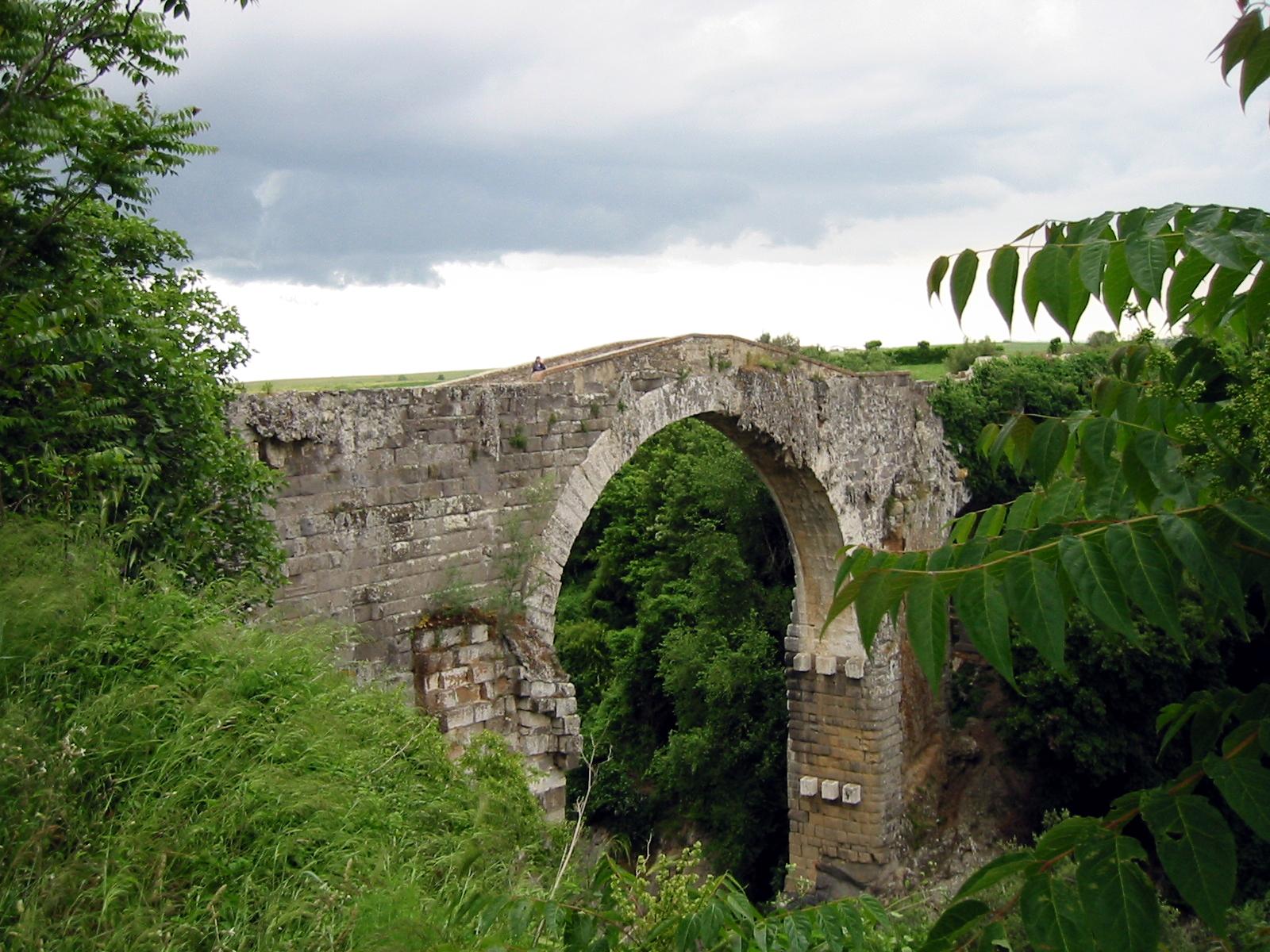 The Ponte dell'Abbadia is a Roman bridge across the Fiora in Vulci, Province of Viterbo