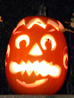 A lovely carved and lighted pumpkin for Halloween.
