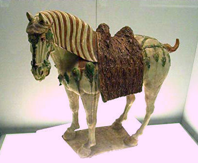 A Chinese Tang dynasty tri-color glazed porcelain horse (ca. 700 AD), using yellow, green and white colors. Tang horse.jpg