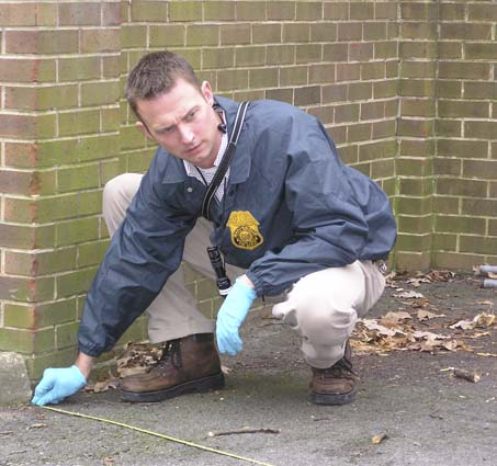 English: A U.S. Army Criminal Investigation Command special agent processes a crime scene on an Army installation. Thirty new sexual-assault investigators will be assigned to various major Army installations worldwide to assume the lead in forming special victim investigative units in support of the Army's Sexual Harassment/Assault Prevention and Response Program known as SHARP. Source: United States Army