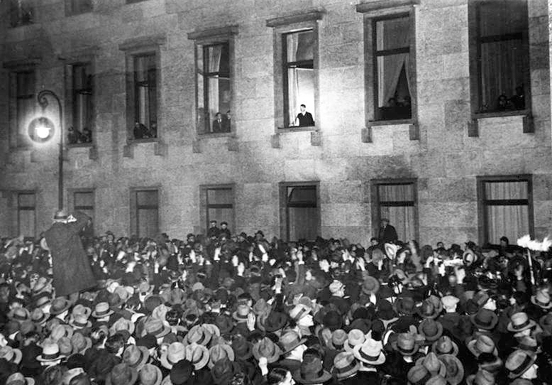 Hitler at the window of the Chancellery on Wilhelmstrasse in Berlin while receiving the ovations of the people on the evening of the day, 30 January 1933