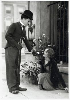 http://upload.wikimedia.org/wikipedia/commons/9/93/Chaplin_City_Lights_still.jpg?uselang=fr