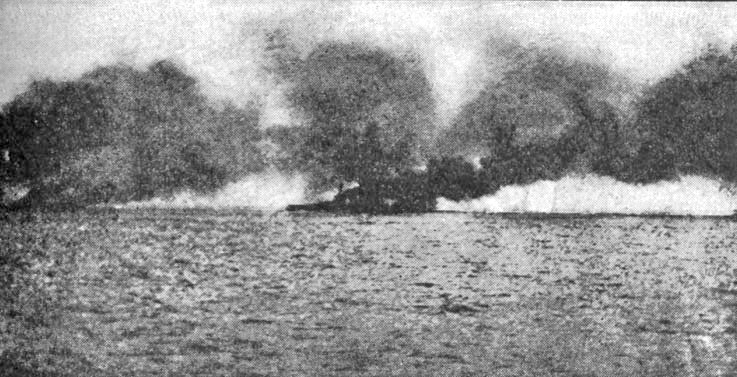 HMS Lion, struck by salvos and burning