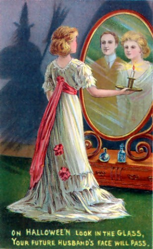 Divination rituals such as the one depicted on this early 20th century Halloween greeting card, where a woman stares into a mirror in a darkened room to catch a glimpse of the face of her future husband, while a witch lurks in the shadows, may be one origin of the Bloody Mary legend.