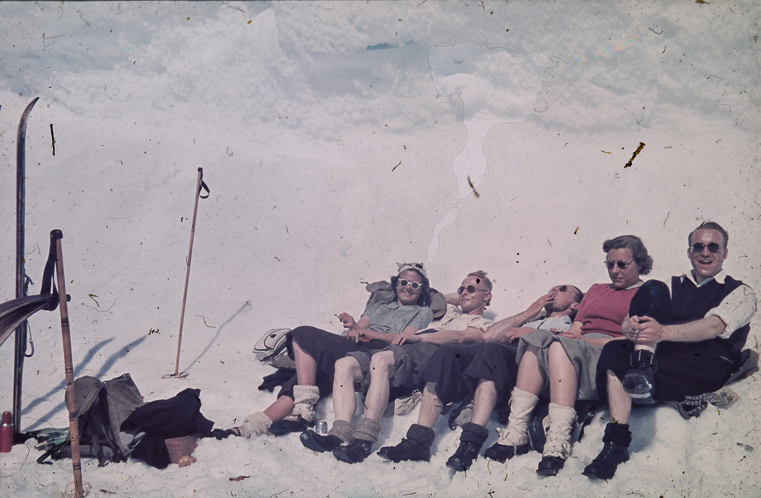 Original color photo of a group of skiers sunbathing on a mountain in Norway, 1937.