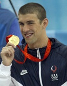 U.S. swimmer Michael Phelps shows off his Olym...
