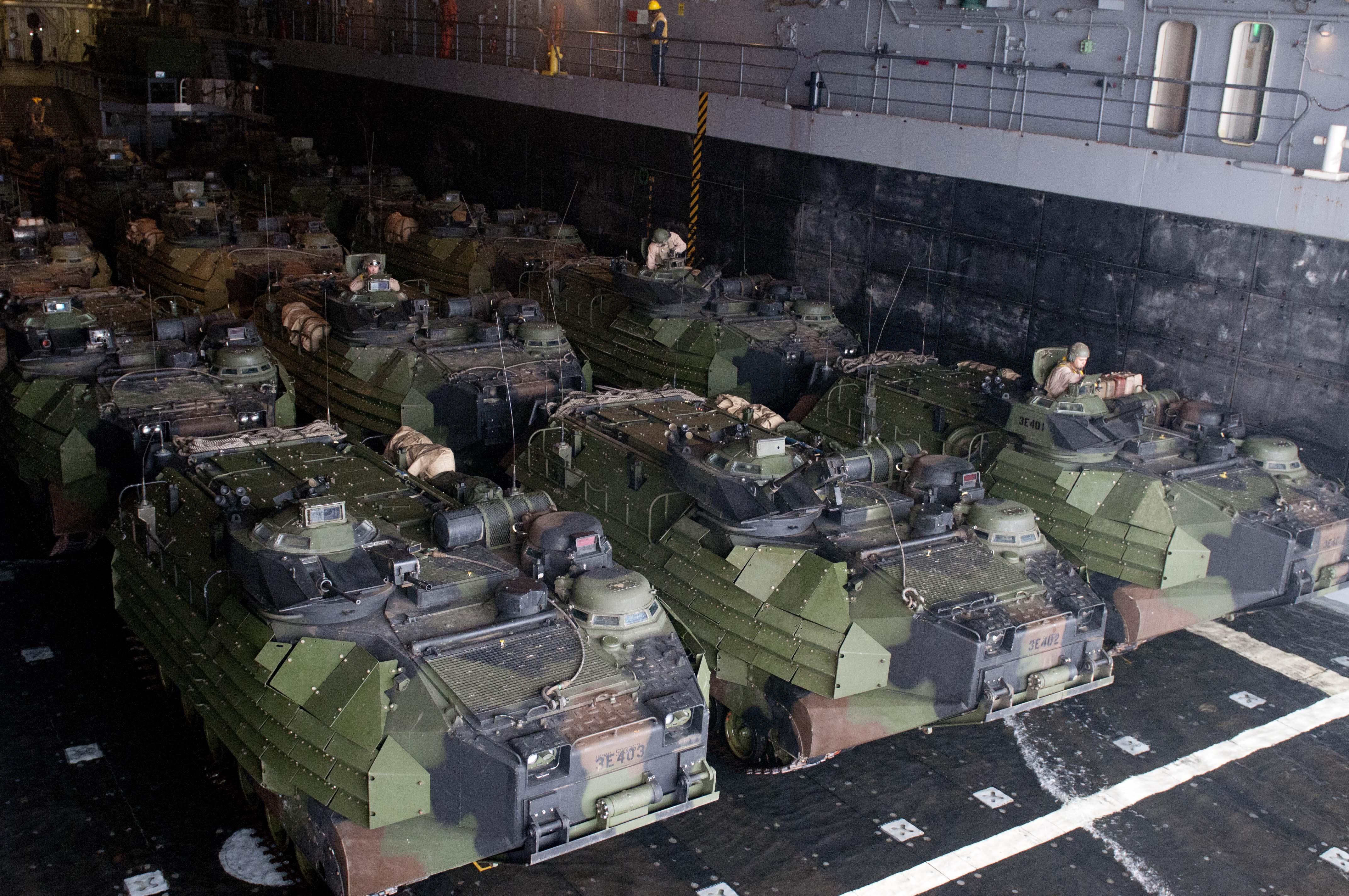 US_Navy_110815-N-PB383-001_Amphibious_assault_vehicles_prepare_to_depart_the_well_deck_of_the_San_Antonio-class_amphibious_transport_dock_ship_USS.jpg