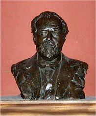 metal bust of an elderly man with moustache, beard and receding hair