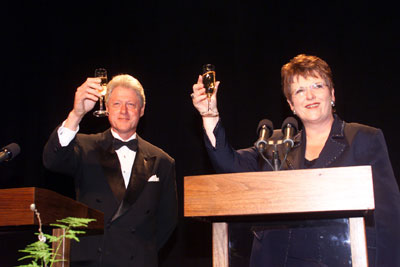 Shipley and US President Bill Clinton join in a toast during a gala at the Royal New Zealand Air Force Museum in Christchurch, 15 September 1999 Bill Clinton Jenny Shipley toast.jpg