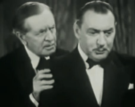 Avec Edward Keane (en) (à d.),dans Man with Two Lives (en) (1942)