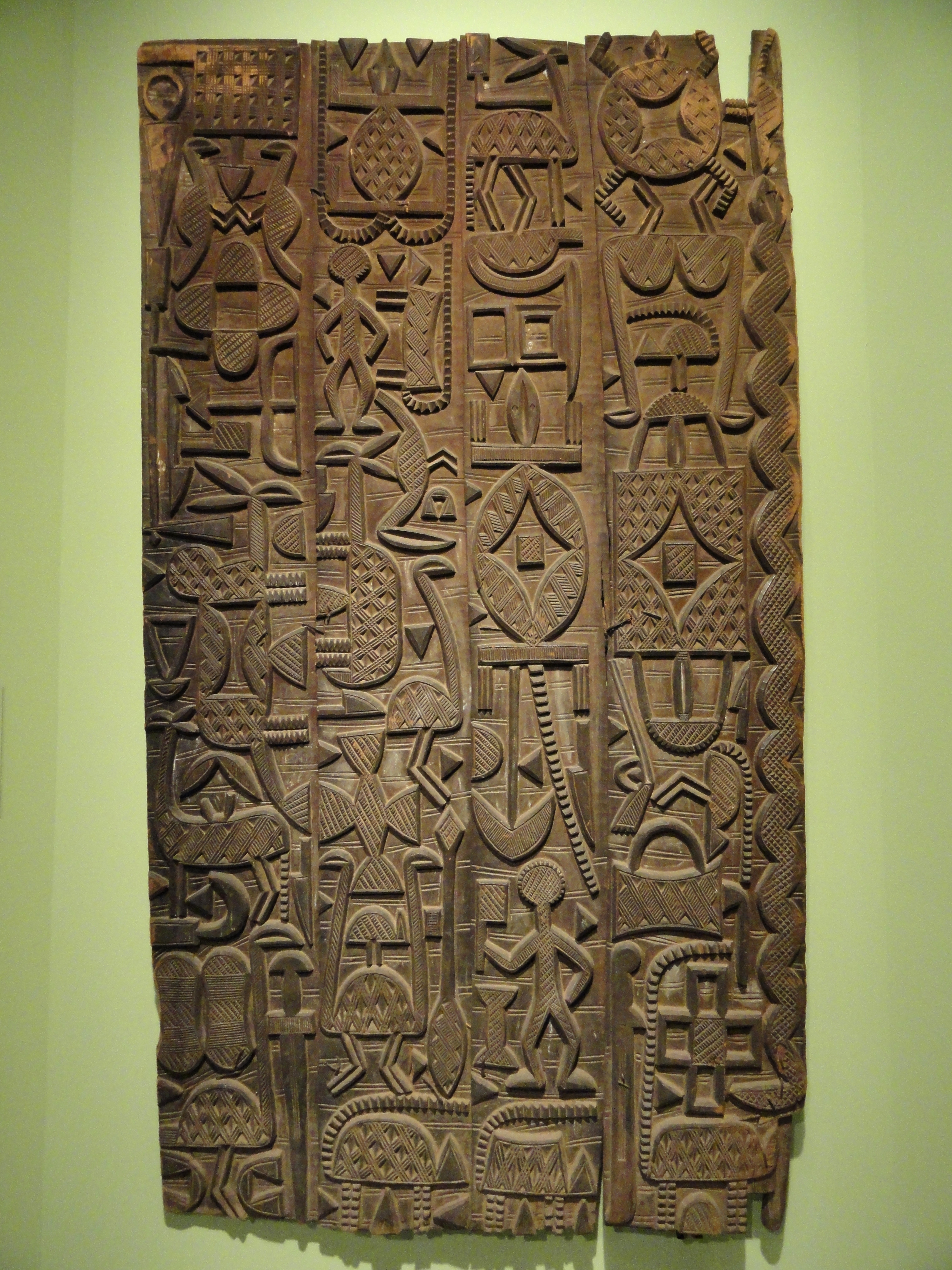 """""""Carved door; circa 1920-1940; wood with iron staples; by Nupe people; Hood Museum of Art (Hanover, New Hampshire, USA). Nupe art is often abstract, being well known for their wooden stools with patterns carved onto the surface."""" from https://en.wikipedia.org/wiki/African_sculpture"""