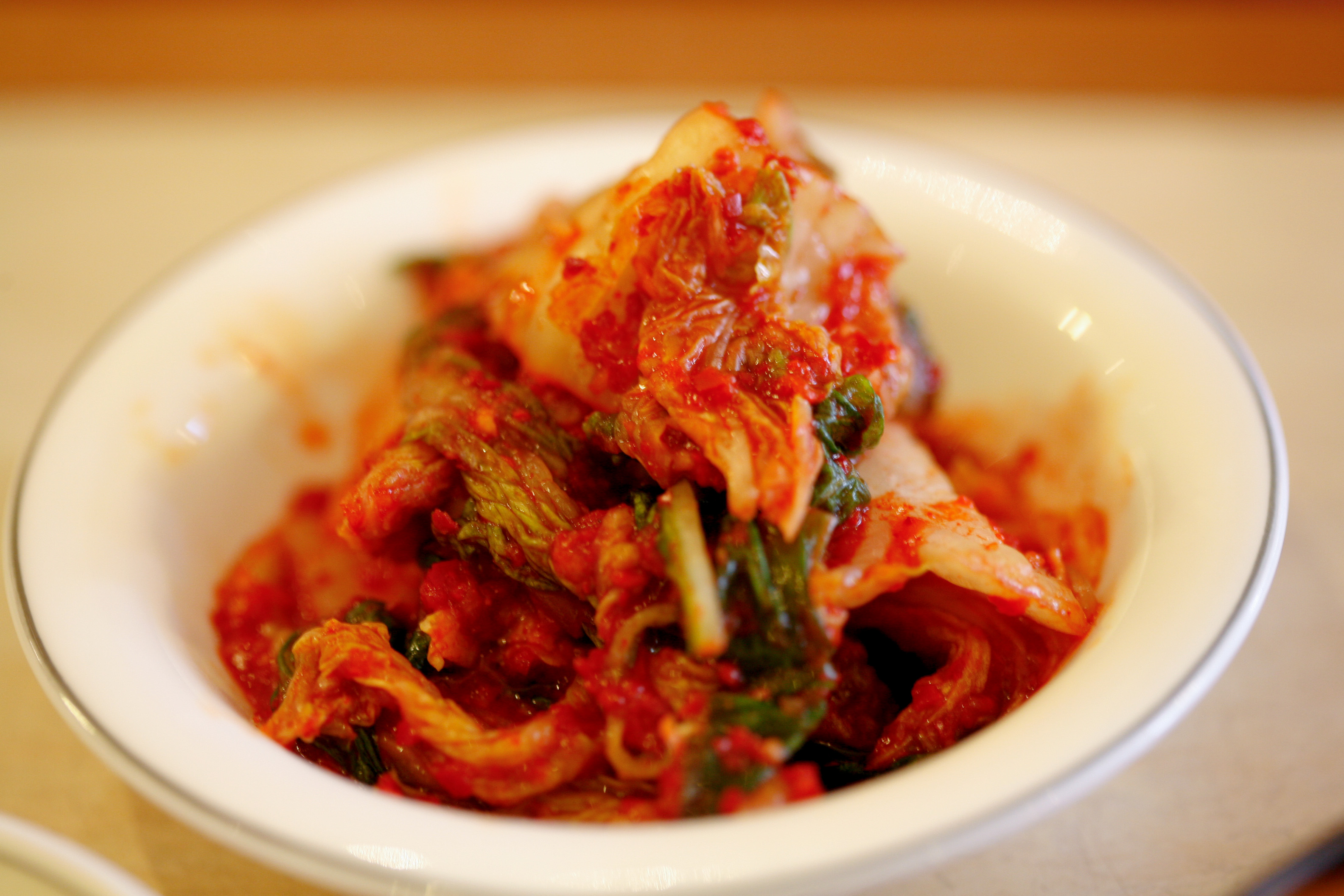 a description of kimchi a traditional korean food Information about popular korean food dishes with free recipes and local restaurant listings in the tri-state area.