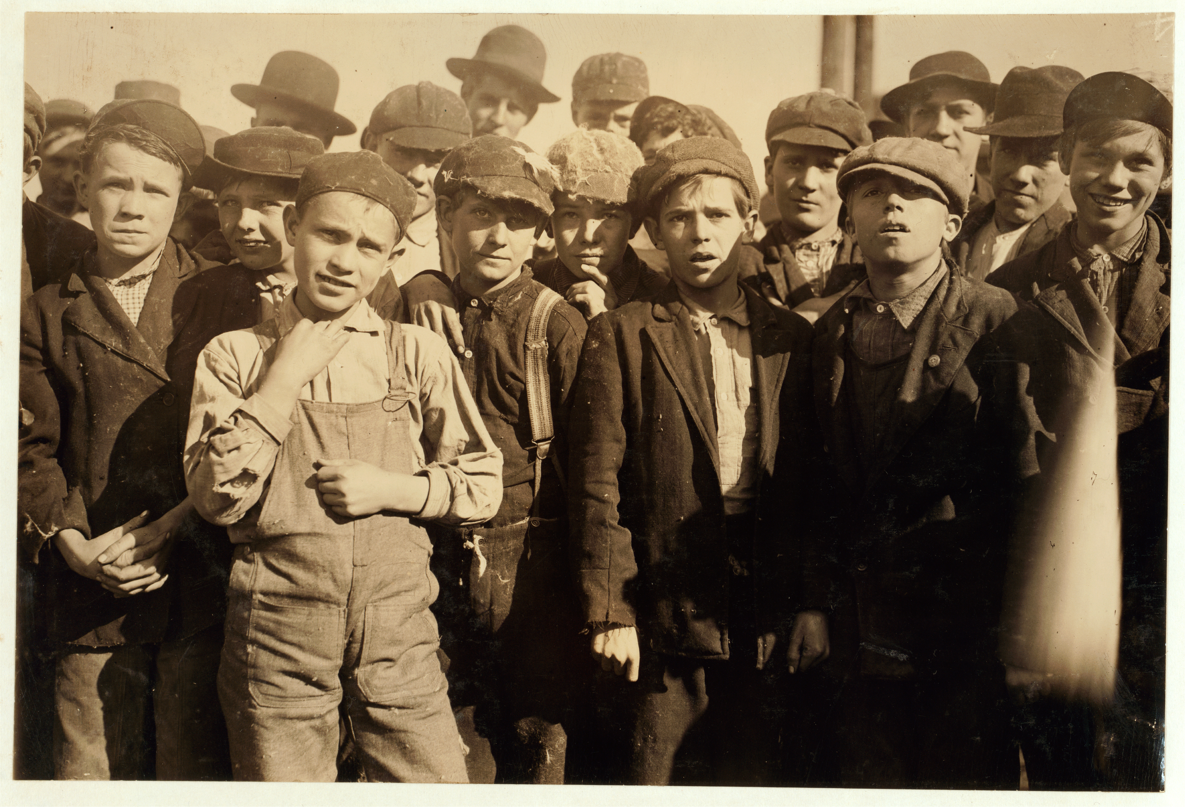 Doffer boys in Knoxville Cotton Mills. Location: Knoxville, Tennessee. Photograph by Lewis Wickes Hine, December 1910. From the National Child Labor Committee.  From the Library of Congress.