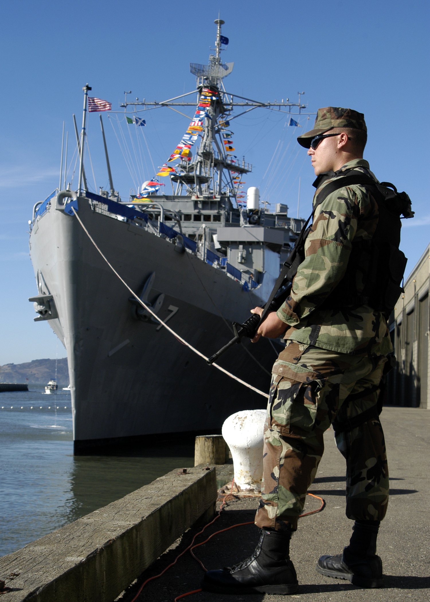 Us Navy Blue Angels >> File:US Navy 031010-N-8029P-002 Master-At-Arms Seaman Travis Slusher stands watch on pier 32 ...