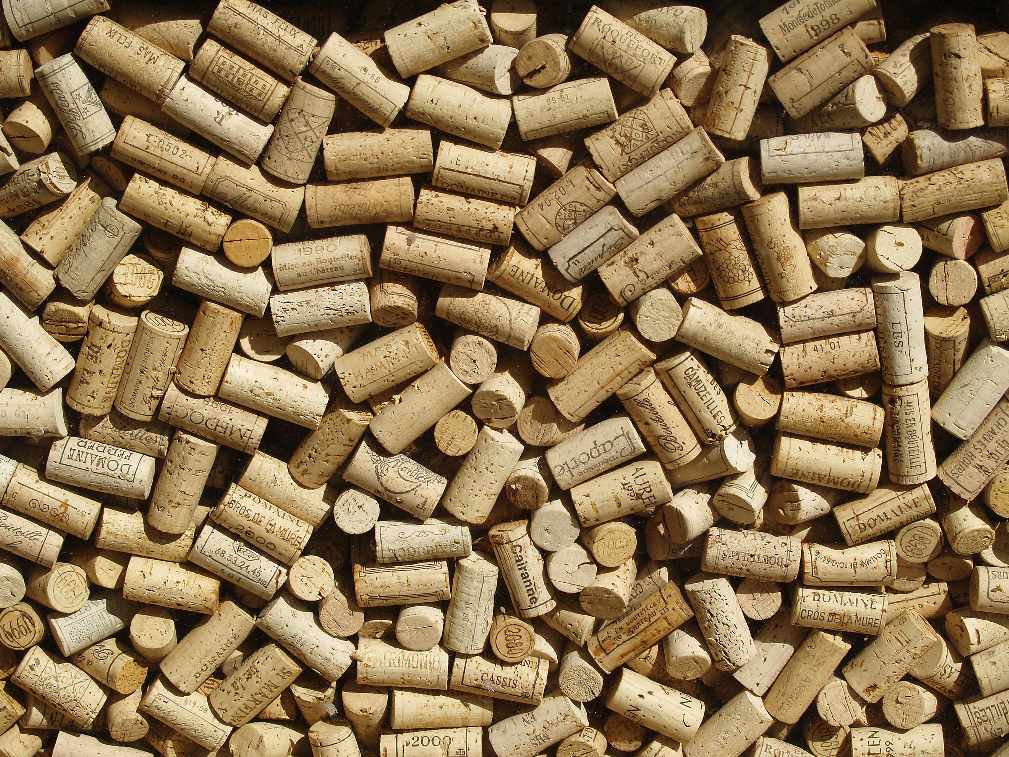 File:Wine bottle corks behind glass.jpg