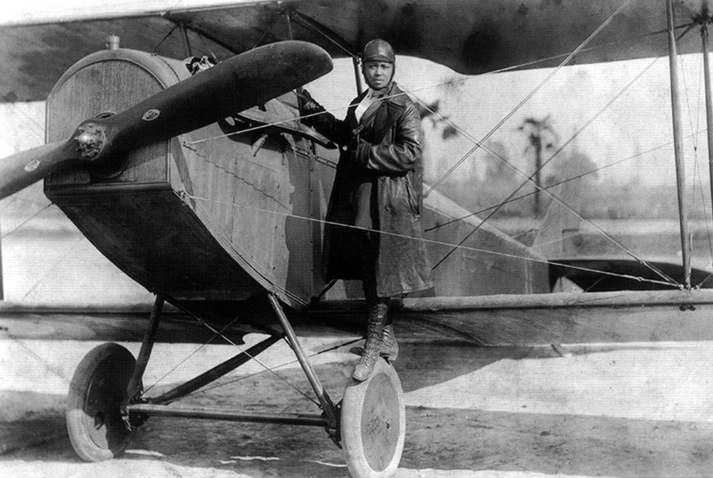 Bessie Coleman and her plane, 1922