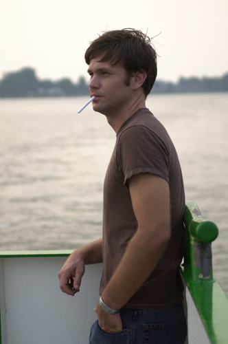 Matthew Davis smoking a cigarette (or weed)