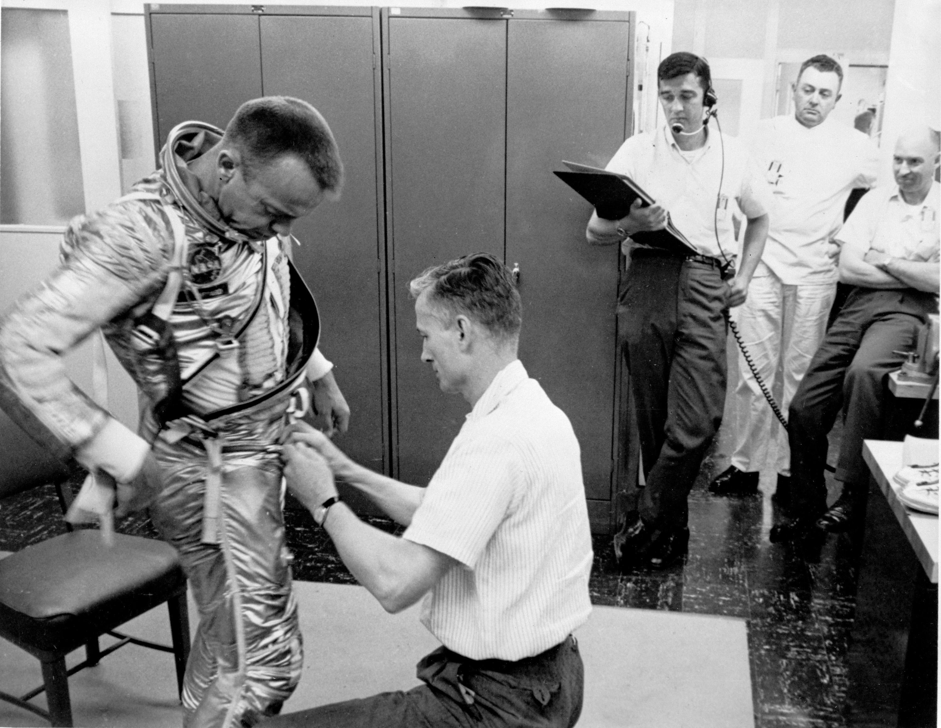 putting on a space suit - photo #21