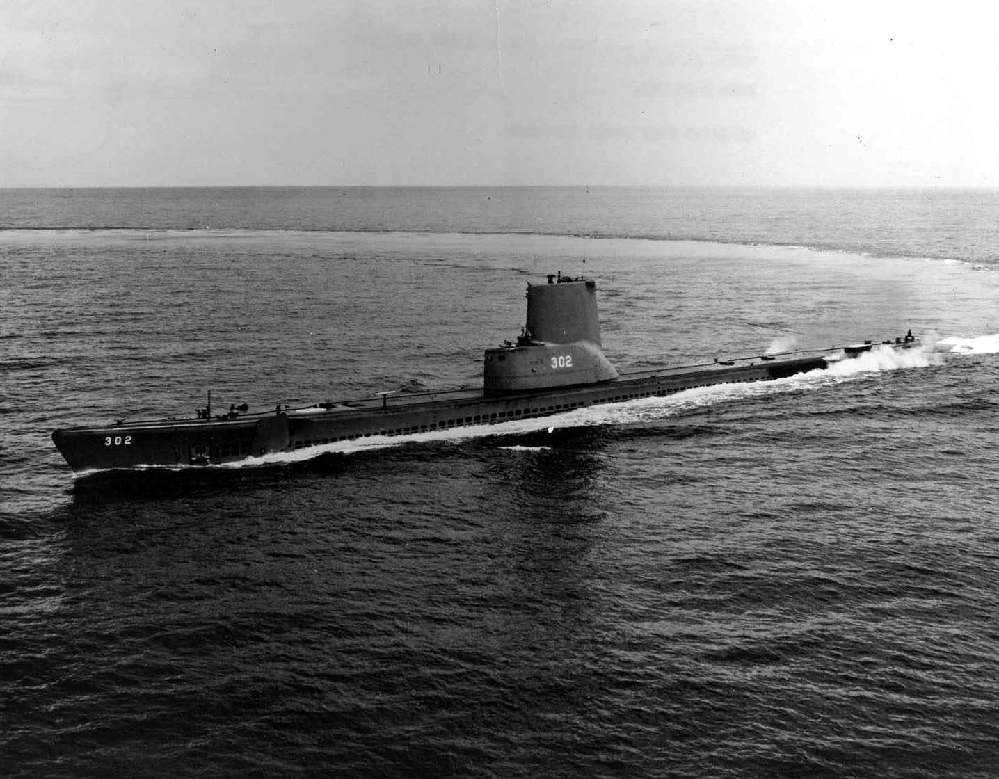 SS-302 submarine does a wide circle in the ocean trailing a wake