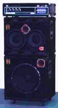 "A 2 x 10"" bass speaker cabinet stacked on top of a 15"" cabinet, with separate bass amplifier ""head"" unit"