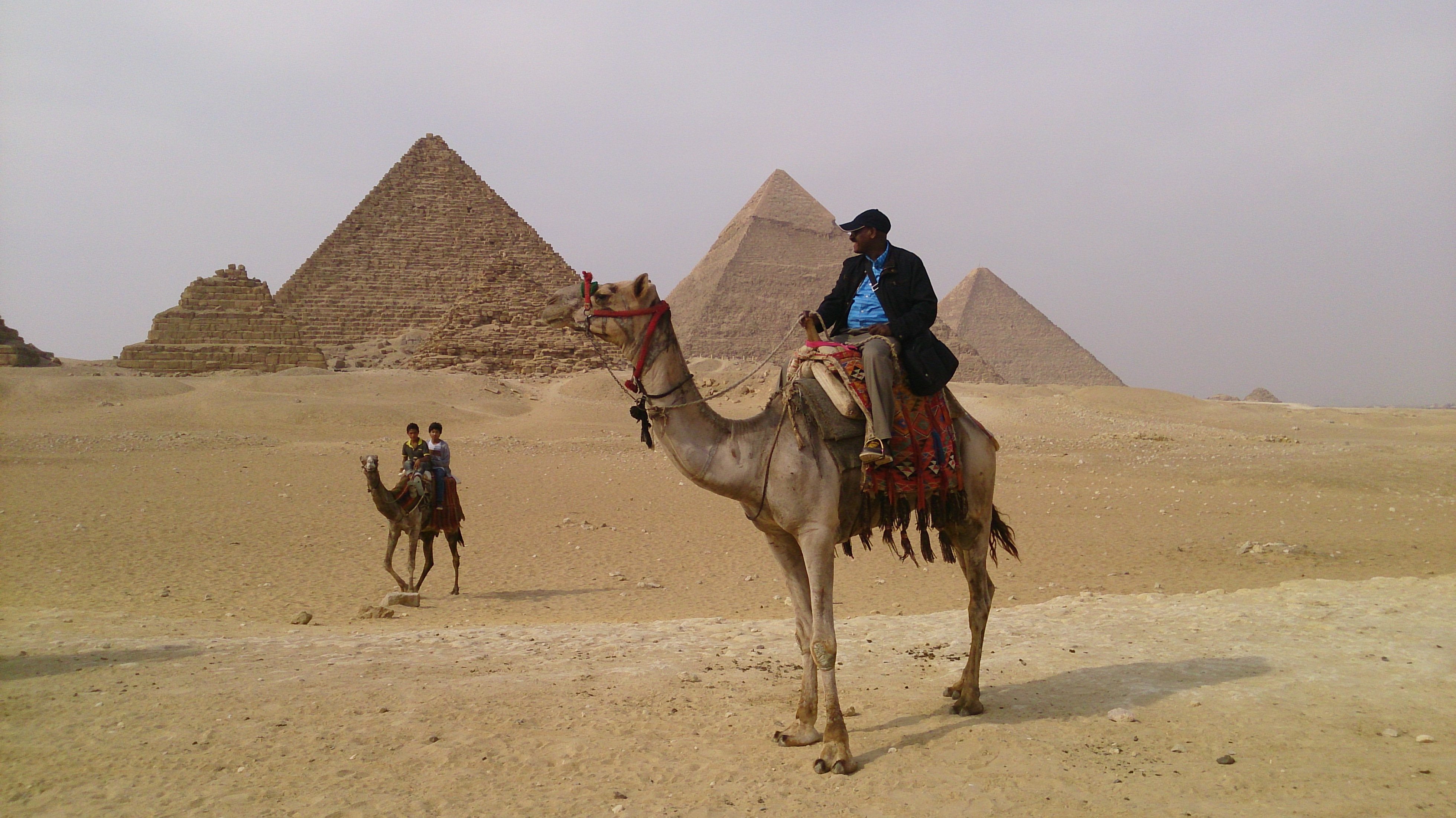 File:Camel riding at the Giza Pyramids in Egypt.JPG ...