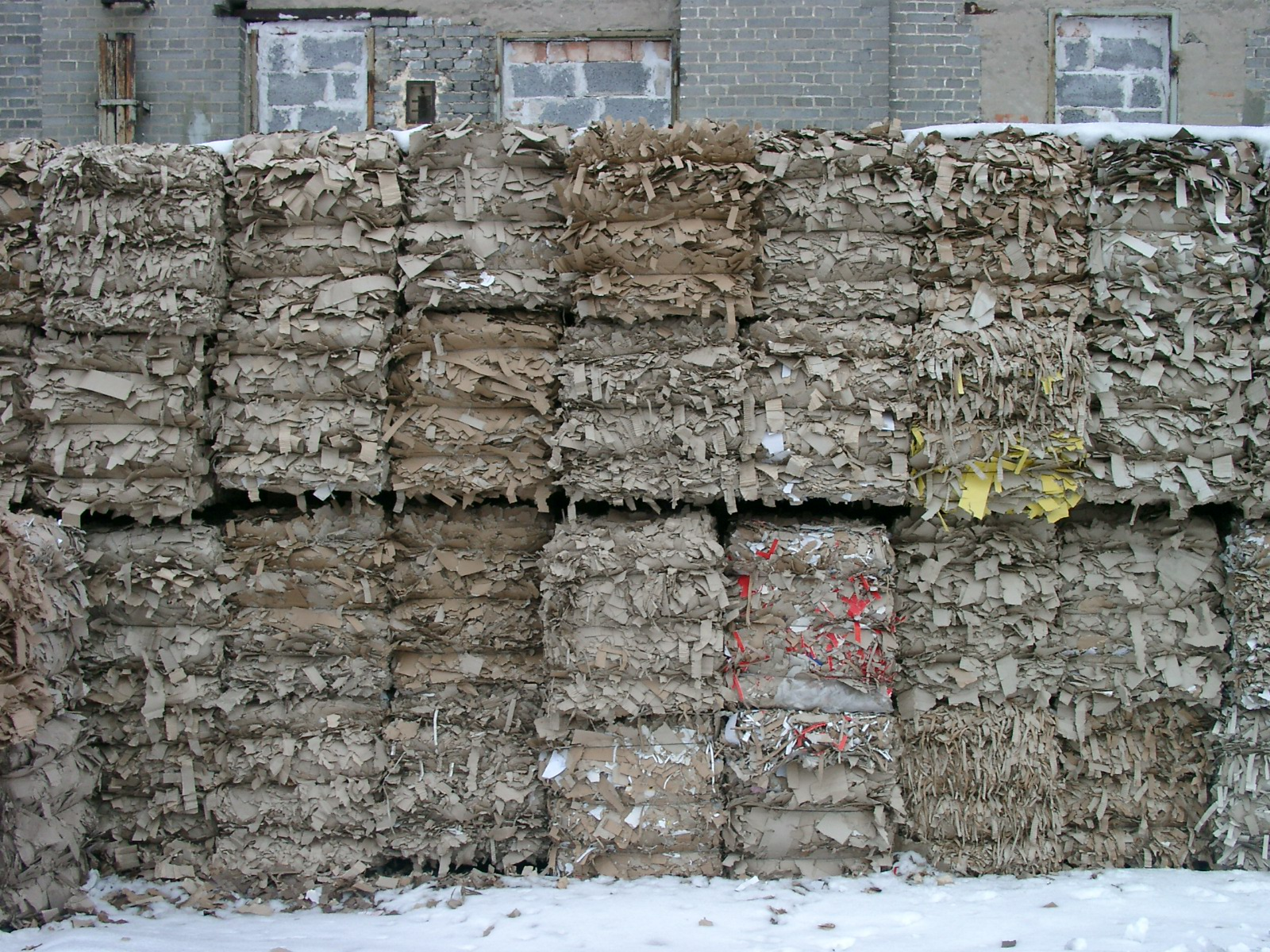 Paper being prepared for recycling at a facility in Poland.