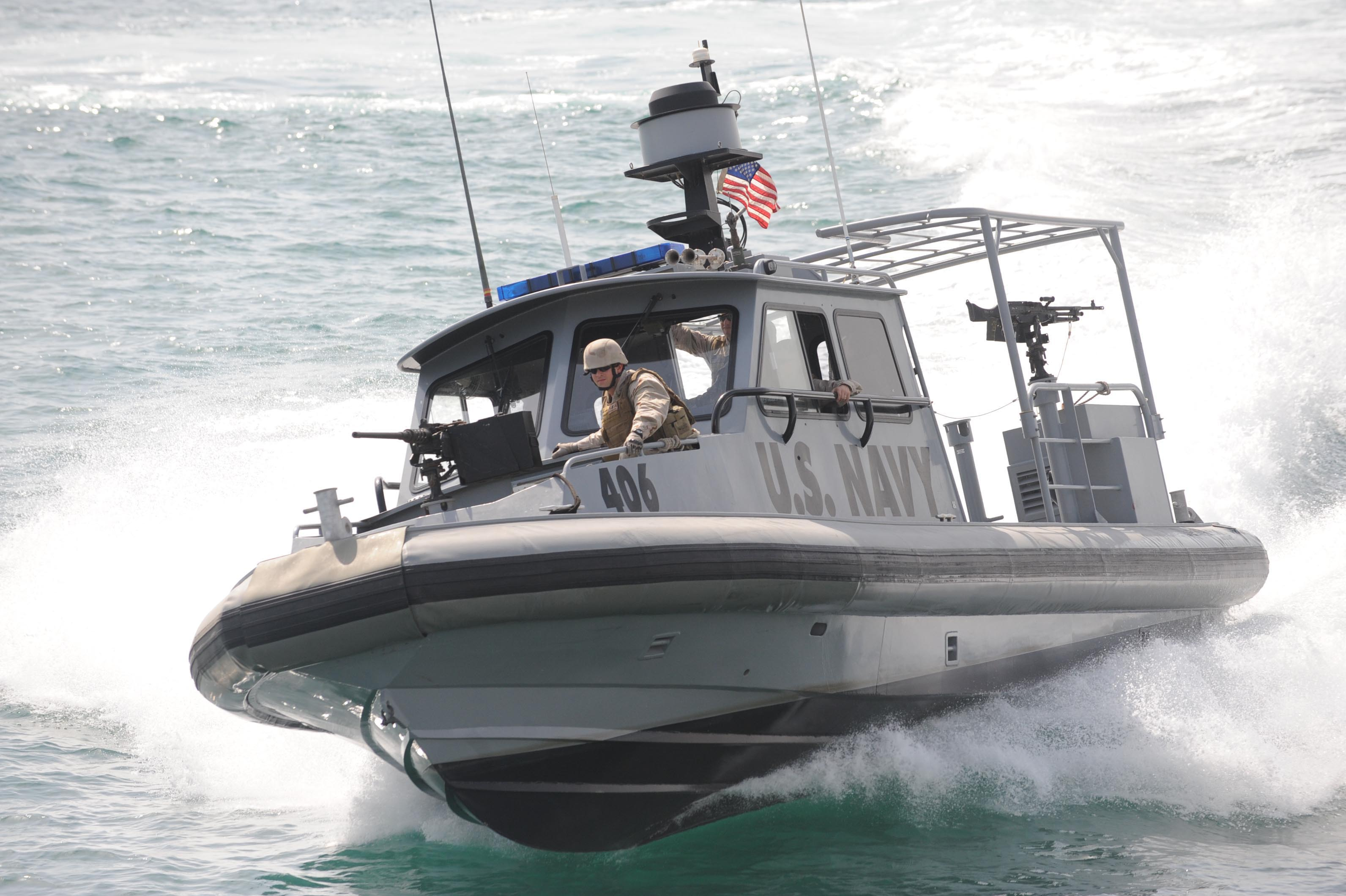 http://upload.wikimedia.org/wikipedia/commons/9/96/US_Navy_090905-N-1452H-516_U.S._Navy_and_U.S._Coast_Guard_personnel_operate_harbor_security,_force_protection_boats_assigned_to_Maritime_Expeditionary_Security_Squadron_(MSRON)_5_as_Combined_Task_Group_(CTG)_56.5_to_provide_por.jpg