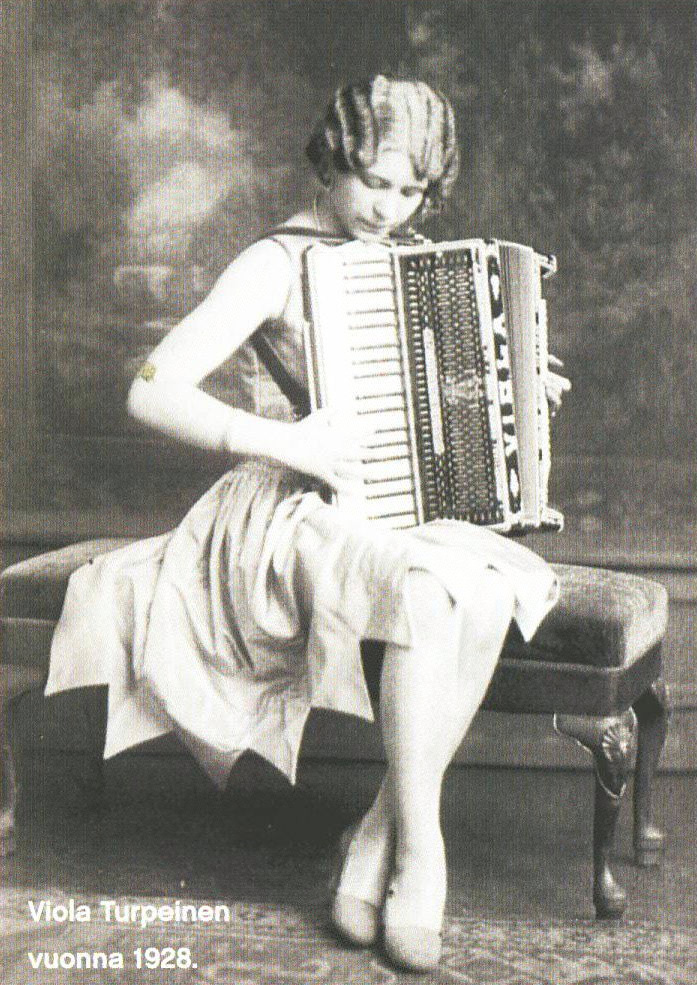 Viola Turpeinen, antique posed photo playing piano accordion