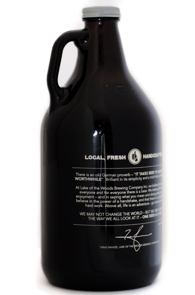File 64 fluid ounce growler style beer bottle in brown glass with a