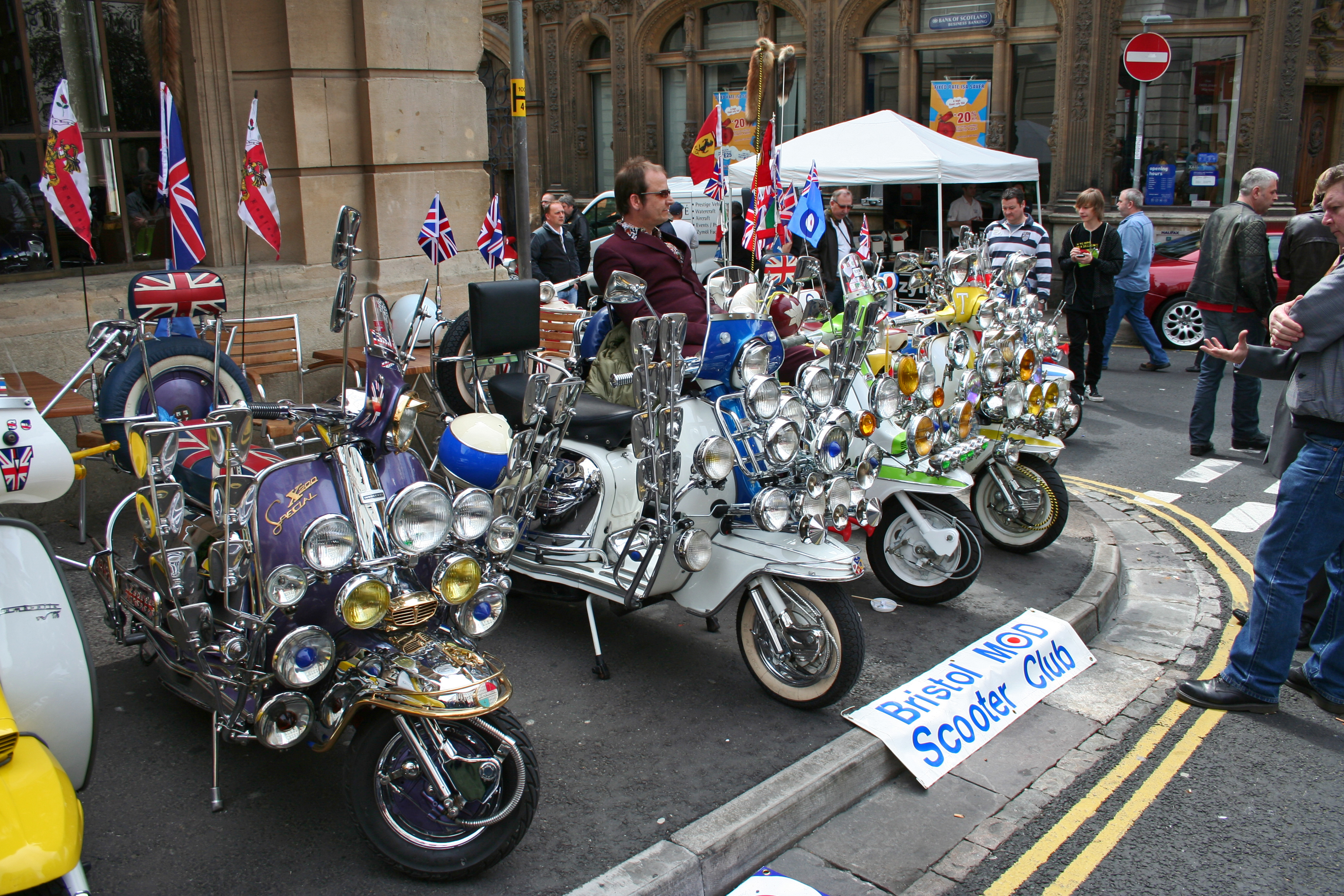 http://upload.wikimedia.org/wikipedia/commons/9/97/Bristol_Mod_Scooter_Club_1.jpg